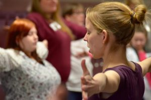 Meg Nalezny, holistic OT occupational therapist, leading a yoga class